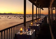 """The Boathouse on the Pier at the Tahoe Beach Retreat & Lodge – The Boathouse is the only restaurant actually out IN Lake Tahoe. It is quite literally """"on the pier,"""" and the views are unbeatable. Paddle over for a drink on the deck, and relax into your next perfect Tahoe evening."""