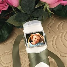 Keep the memory of your lost loved ones close to your heart during your wedding ceremony with this silver plated wedding bouquet photo buckle memory charm.