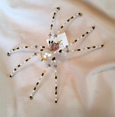 Approximately 6 long. Inspired by the story of the Christmas Spider: Ukraine...There once was a widow, who lived in a small hut. One day a pine cone dropped on the floor and it took root. Her children were excited that they would have a tree for Christmas. All summer long they made plans