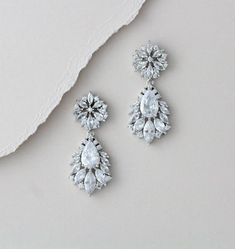 Sparkling and glamorous, these silver clear cubic zirconia chandelier earrings are a great choice for weddings or any special occasion. They feature fabulous rhodium plated, pear shaped designs gorgeously adorned with glittering clear cubic zirconia stones. Size: 1-3/4 long, 3/4 wide Pick the post