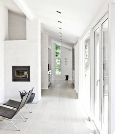 Beautifully Simple Interior In White Themes From NORM Architects Alley