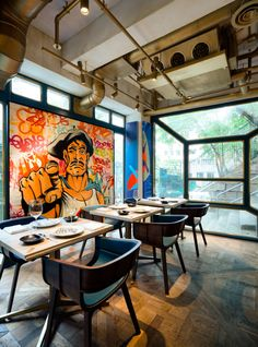 the restaurant is an ongoing project that works with artists, both contemporary and street, from around the world and displays their work together in the space.