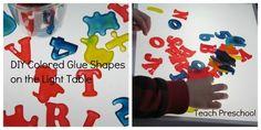 DIY colored glue shapes on the light table by Teach Preschool
