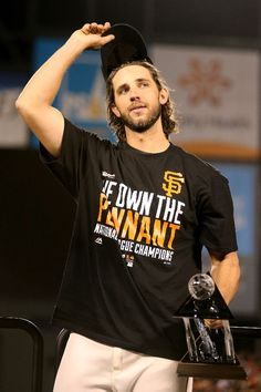 SAN FRANCISCO, CA - OCTOBER 16: Madison Bumgarner #40 of the San Francisco Giants waves to the crowd with the NLCS MVP award after the Giants defeat the St. Louis Cardinals 6-3 during Game Five of the National League Championship Series at AT&T Park on October 16, 2014 in San Francisco, California. (Photo by Christian Petersen/Getty Images)