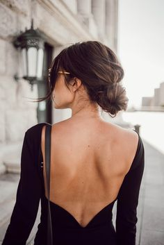 Beautiful Backless dress and low bun. Worn with cute black lace up heels and red lips