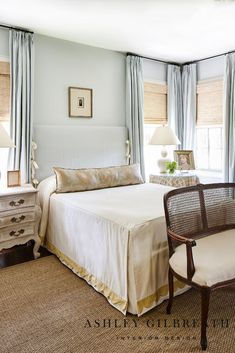 ASHLEY GILBREATH INTERIOR DESIGN: We love the neutral, blue, and gold tones of this bedroom. The tailored drop bedspread with gold scalloped trim is set off by a cloud blue slipcovered headboard. A sisal rug adds texture to the space. Slipcovered Headboard, Slipcovers, Luxury Bedroom Design, Interior Design, Ashley Gilbreath, Basement Bedrooms, Cottage, Luxurious Bedrooms, Bed Spreads