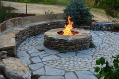 This Outdoor Dream in Richmond, VA creates a rustic retreat for a suburban couple. Believe it or not, the patio is composed of Techo-Bloc pavers blending perfectly with the natural stone boulders, sitting wall and fire pit. One of our absolute favorites.