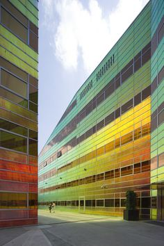 "La Defense, Almere, Netherlands, ""Dichroic"" facade material by Chameleon is the reason for the pin. Colour Architecture, Interior Architecture, Interior Design, Glass Facades, Dichroic Glass, Cladding, Colored Glass, Mid-century Modern, Contemporary"