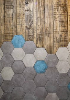 Hexagon tiles meet wood tiles in this very cool flooring design. Modern and contemporary mix of materials.
