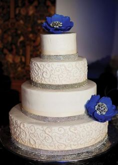 "We love the pop of ""something blue"" on this decadent cake from Mishelle Handy Cakes. Photo by Tara Lokey Photography. #wedding #cake"