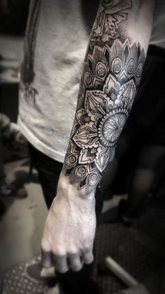 forearm tattoo, man wearing, grey top, black jeans, mandala symbols Mandala tattoos have taken the world by storm. What is their symbolism? Read our article to find out the real meaning and beauty of a mandala tattoo. Mandala Tattoo Sleeve, Geometric Sleeve Tattoo, Mandala Tattoo Design, Sleeve Tattoos, Full Arm Tattoos, Wrist Tattoos For Guys, Tattoos For Women, Men Back Tattoos, Forarm Tattoos