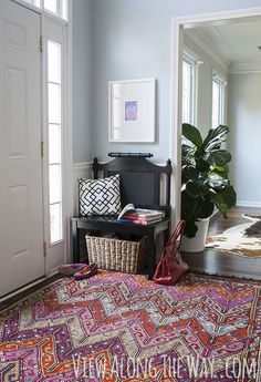 How to turn a headboard into a bench for extra seating in an entry