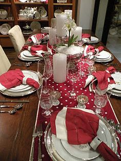 Christmas table decorating...with use of white and red themed assessories from china, napkins and candles with pop of polkadots from the tablerunner.