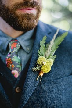 billy balls boutonnieres - photo by Laurels & Stars Photography http://ruffledblog.com/wisconsin-bohemian-wedding-ideas