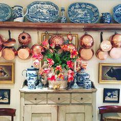Stunning kitchen vignette with art, copper, blue & white porcelains & tulips at Halcyon Farm