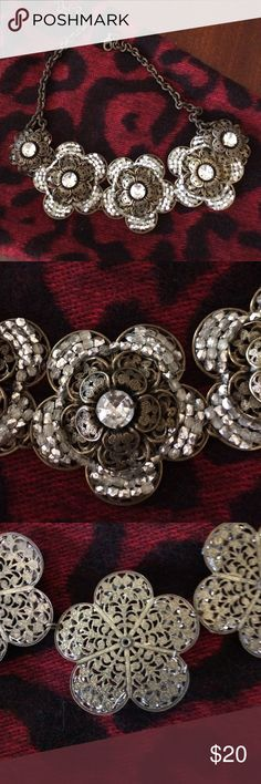 Anthropologie brass flower necklace w/ white stone Anthropologie vintage looking brass flower necklace with white stones.  Very feminine! Anthropologie Jewelry Necklaces