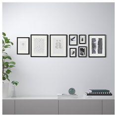 IKEA - KNOPPÄNG, Frame with poster, set of black, The included collage template and coordinated motifs make it easy to create your own personal wall collage. Motif created by Sanna Nordin. Motifs are in place; At Home Furniture Store, Modern Home Furniture, Affordable Furniture, Ikea Frames, Frames On Wall, Kitchen Wall Tiles, Kitchen Decor, Ikea Home, Plastic Box Storage