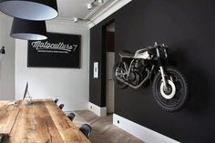 man cave garage Discover the art of decorating your manly space with the top 100 best man cave decor ideas for men. Explore cool interior designs, wall art and more. Motorcycle Shop, Motorcycle Garage, Motorcycle Man Cave Ideas, Motorcycle Workshop, Motorcycle Helmets, Black Painted Walls, Design Garage, Deco Cool, Interior Styling