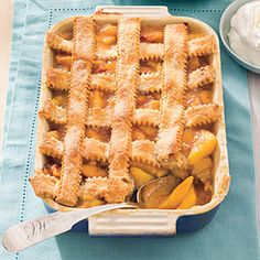 Pecan-Peach Cobbler | Perfect your peach cobbler by topping it with a flaky pecan pastry. Serve warm or cold with sweetened whipped cream or vanilla ice cream.