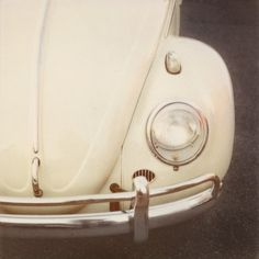White Retro Bug Car, my dad loved working on these cars