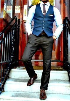 Men's Dark Brown Leather Brogues, Charcoal Dress Pants, Gold Watch, Dark Brown Leather Belt, White Pocket Square, Blue Waistcoat, Dark Brown Tie, and White Dress Shirt