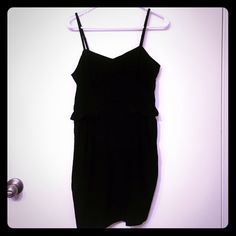 Little Black Dress Peplum like with frilly detail with pockets. Zip back. Silk like material.      ☀☀️️I accept most reasonable offers on all items and I do offer a 20% bundle discount on 2 or more items. 🚫️No trades🚫☀️☀️   🌀 I ship most items within 2 days of purchase🌀 Dresses