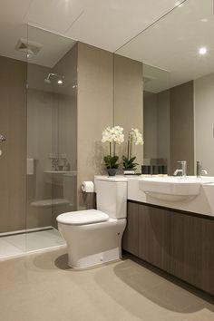 Beautiful modern bathroom, neutral, interesting countertop / toilet idea.