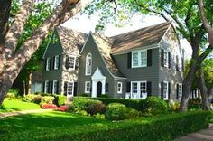 dark grey house with black and white trim - I just love this style house.. so much character