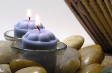 Fill a spa-themed bedroom with soothing scented candles.