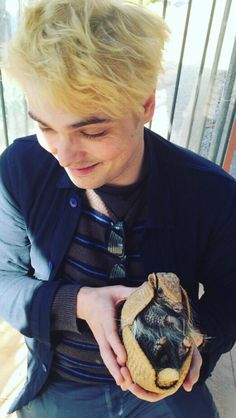 One does not simply pass up a picture of Gerard Way holding an armadillo