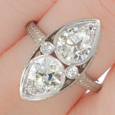 Original Art Deco double pear diamond and platinum engagement ring. View our collection of antique, Art Deco, and modern jewellery from our new catalogue at www.rutherford.com.au