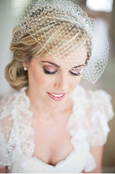 Lovely bridal makeup with a birdcage veil