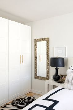 White wardrobe, white walls, gold accents