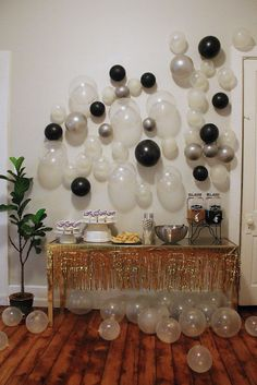 A balloon wall as a dessert table backdrop