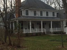 Hard to see but example of wrap porch leading to screen porch, and has hipped roof, like the straight columns no pedestals, Dorset road near little falls pkwy end, CD