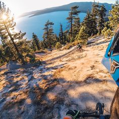 "gopro on Instagram: ""@kellymcgazza and @aaronchase take on some beautiful terrain at Bike Athlete Camp in Lake Tahoe! Chat live with them and the rest of the #GoPro crew this afternoon at 4:30pm PST by clicking the link in our profile. #MTB"""