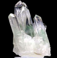 quartz crystal with fuchsite inclusions (phantoms)