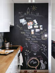 A chalkboard wall is great for message reminders and adding personality to the kitchen