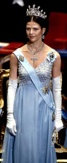 from http://nobelprize.org Queen Silvia of Sweden 1979 Layers of chiffon in light blue and warm rose-pink, topped with a bodice encrusted ...