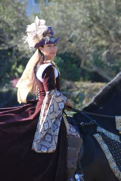 This custom made Renaissance Tudor equestrian gown was made by me, The Very Merry Seamstress. You can find my designs at http://www.verymerryseamstress.com
