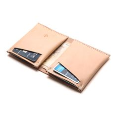 The classic slim wallet with a modern twist. It is designed with a large compartment for unfolded bills and two neat compartments for cards, with two slots for quick access to frequently used cards. The minimalist wallet is crafted from Italian vegetable tanned leather and stitched by hand, its the perfect companion for everyday use.  // Material // - Italian full-grian vegetable tanned leather - Color: Natural - Waxed linen thread  // Details // - 100%...