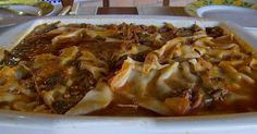 Experimente uma lasanha de berinjela feita com massa de pastel