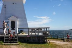 Ice Cream shop inside Neil's Harbor Lighthouse on the Cabot Trail Cabot Trail, Motorcycle Travel, Water Tower, Nova Scotia, Lighthouses, The Locals, Kayaking, Places Ive Been, Road Trip