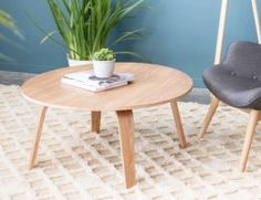 The Panda Round Coffee Table in Natural Oak is made of moulded plywood; the legs provide an elegant curve supporting a slim tabletop. The table top is shaped with a beautifully designed recess. A warm and unique coffee table that can adorn any decor.