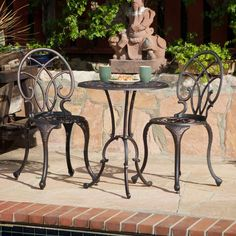 Features:  -Set includes table and 2 side chairs.  -Material: Cast Aluminum.  -Wide-leg stance adds stability.  Product Type: -Bistro set.  Frame Material: -Aluminum.  Table Top Material: -Metal.  Sty