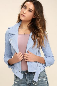 Having a moto moment? Then you won't want to pass up the Blank NYC Backhanded Periwinkle Blue Suede Leather Moto Jacket! Genuine suede leather is adorned in silver zippers and snaps along the collared neckline, long sleeves, and belted hem. Two functioning zipper pockets frame an asymmetrical front zipper, while shoulder epaulettes, and a snap button pocket add classic moto details.