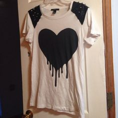 Punk Nu goth Forever 21 Spiked Tshirt Epic Tshirt with a dripping heart graphic, spikes and faux leather patches on the shoulders. Worn a few times. Shirt is long in length but probably only fits like a tunic for xsmalls. I love this shirt but I always fear about staining it since its white and I end up never wearing it so I am going it finds a good home where it'll be worn a lot. Forever 21 Tops Tees - Short Sleeve