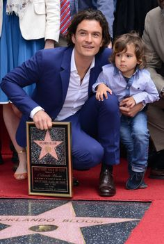 Orlando Bloom gets support from his son Flynn as he receives a star on the Hollywood Walk of Fame on April 2, 2014