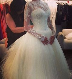 Tight sparkly bodice with lace sleeves and high neck, ultimate winter wedding dress ♥