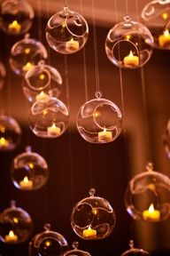 Tea lights in hanging glass ornament candle holders